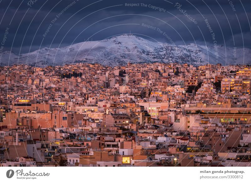 Athens. Winter Snow Mountain Cold Europe Mediterranean Greece Greek Attica Areopagus cityscape Dusk Penteli Pentelicus City urban Evening