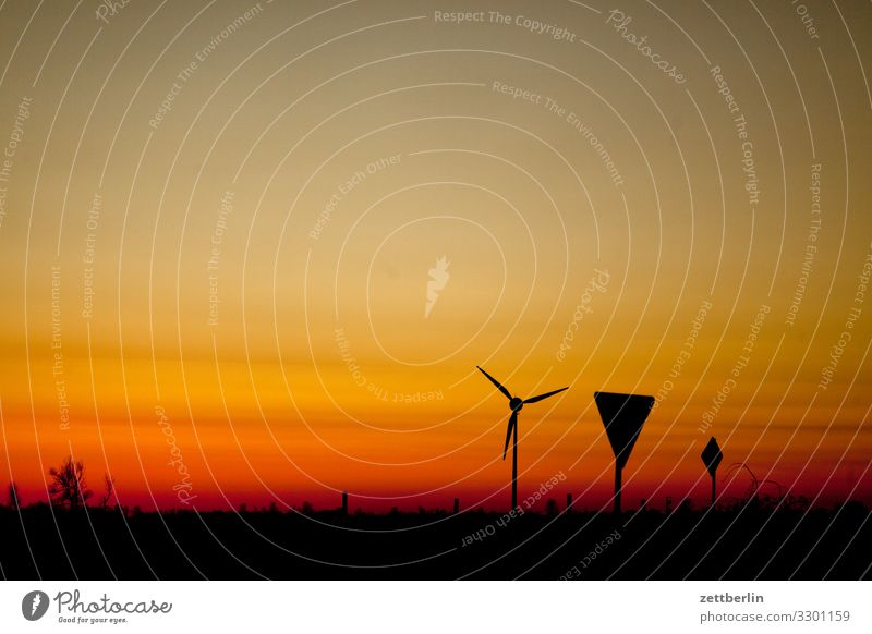 Wind turbine and traffic signs Village Twilight Far-off places Horizon Landscape Mecklenburg-Western Pomerania Deserted Baltic Sea Rügen Sun Sunset Copy Space