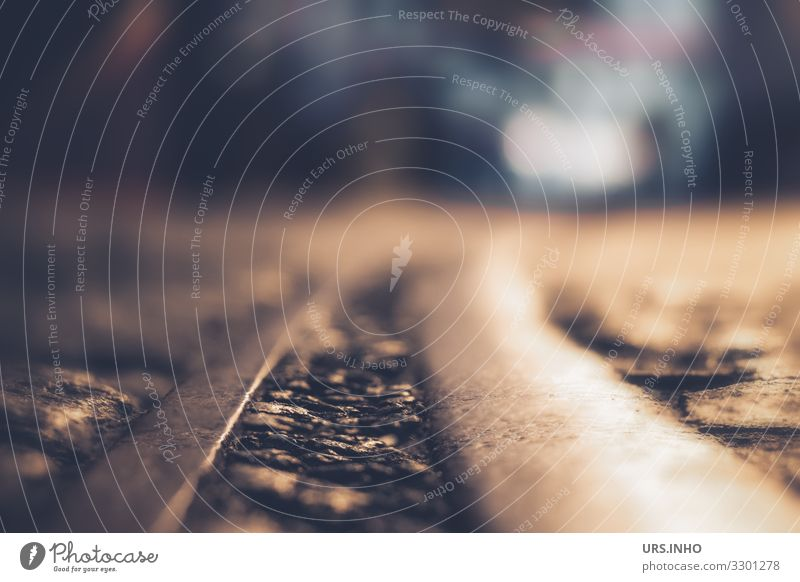 Road with rails in the night and car headlights in the background Deserted Traffic infrastructure Road traffic Street Railroad tracks Tram line Threat conceit