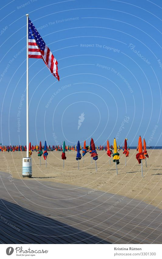 flagged Lifestyle Leisure and hobbies Vacation & Travel Freedom Beach Ocean Sand Sky Horizon Coast Sign Flag Warmth Multicoloured Sandy beach Promenade