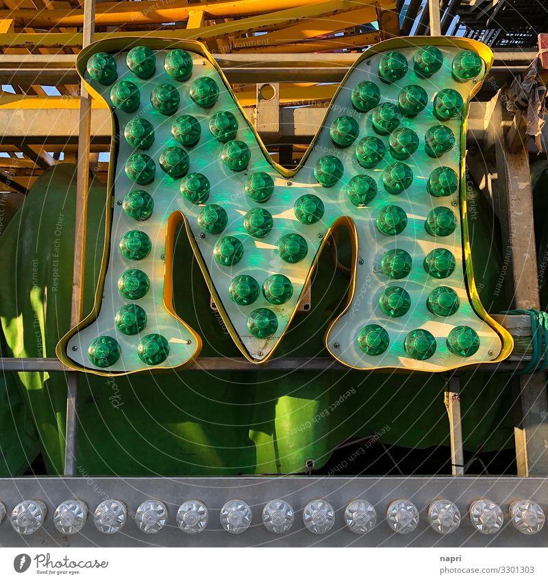 m Characters M Green Colour Joy Idea Communicate Creativity Joie de vivre (Vitality) Fairs & Carnivals Electric bulb Latin alphabet Colour photo Exterior shot