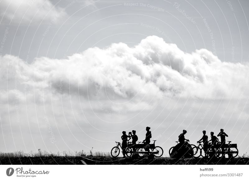 Silhouette of resting cyclists on a mountain with clouds Leisure and hobbies Mountain biking Mountain bike Trip Adventure Cycling tour Bicycle Human being