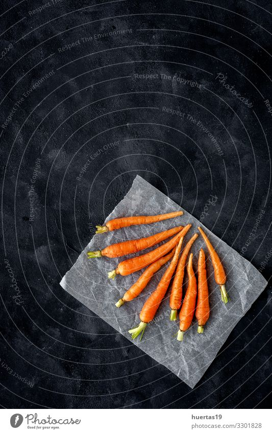 Delicious roasted carrots from above Food Vegetable Herbs and spices Lunch Dinner Vegetarian diet Diet Lifestyle Healthy Eating Fresh Natural Above Orange Black