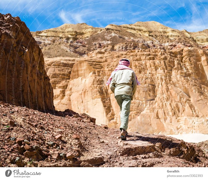 Bedouin climbs a mountain in a canyon in Egypt Dahab Exotic Vacation & Travel Tourism Summer Mountain Climbing Mountaineering Man Adults Nature Landscape Sky