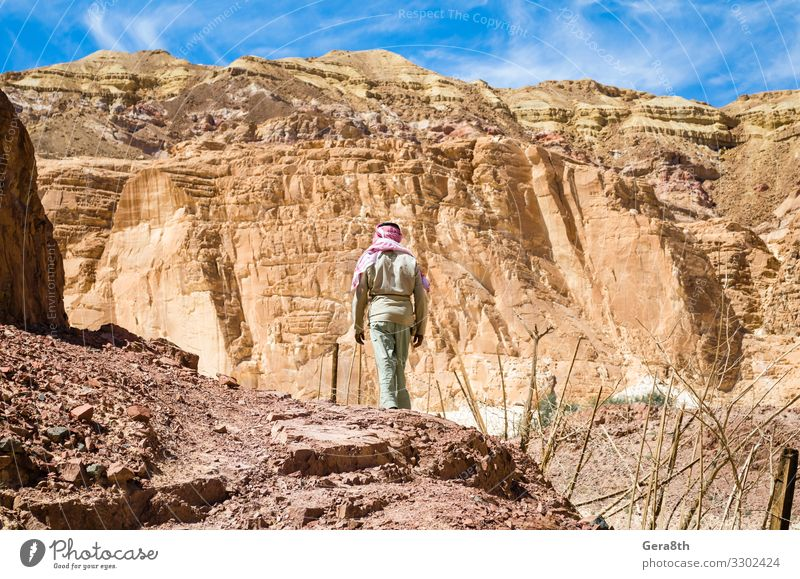 Bedouin climbs a mountain in Egypt Dahab South Sinai Sky Vacation & Travel Nature Man Summer Blue Colour White Landscape Clouds Loneliness Mountain Adults