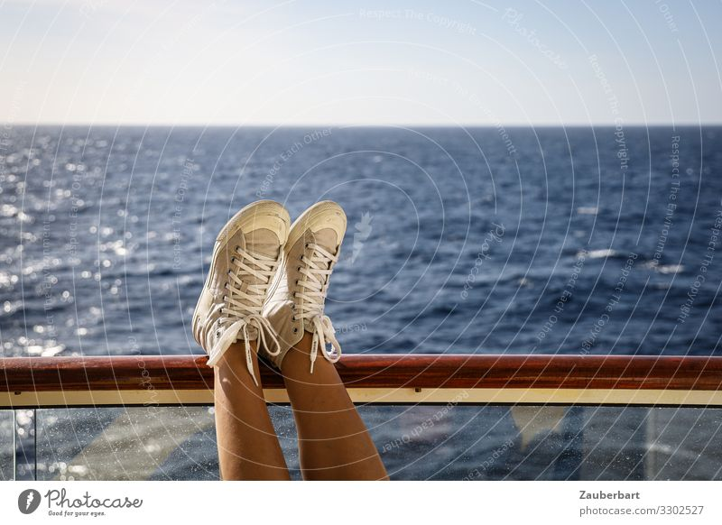 Relaxation and sea Vacation & Travel Freedom Cruise Ocean Balcony Handrail Woman Adults Legs Feet 1 Human being 30 - 45 years Sky Navigation Sneakers To enjoy