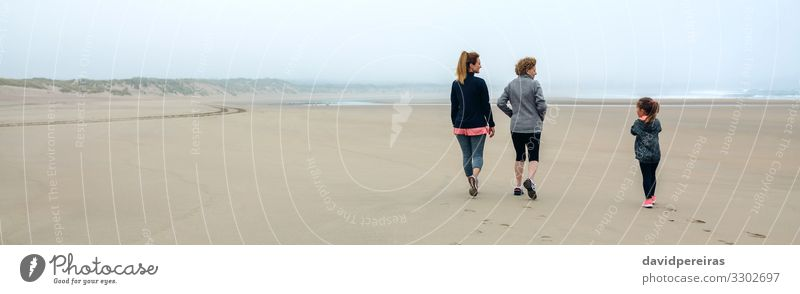 Three generations female walking on the beach Lifestyle Beach Child Internet Human being Woman Adults Mother Grandmother Family & Relations Sand Sky Autumn Fog
