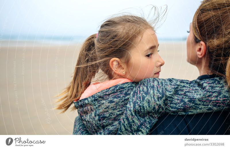 Back view of mother and daughter on the beach Lifestyle Happy Beautiful Calm Beach Ocean Child Human being Woman Adults Mother Family & Relations Sand Autumn