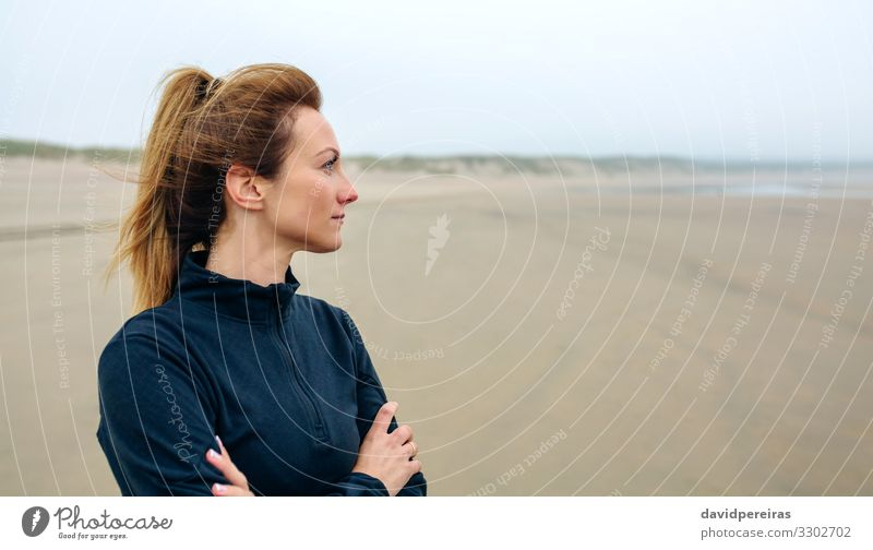 Woman looking at sea Lifestyle Beautiful Meditation Beach Ocean Human being Adults Sand Autumn Fog Think Smiling Authentic Serene Loneliness Future positive