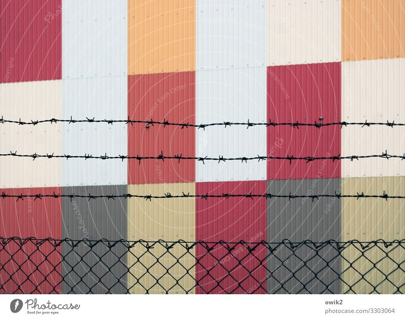 Cultural outcasts Art Wall (barrier) Wall (building) Facade Barbed wire fence Fence Wire netting Metal Sharp-edged Simple Modern Point Thorny Gray Orange Red