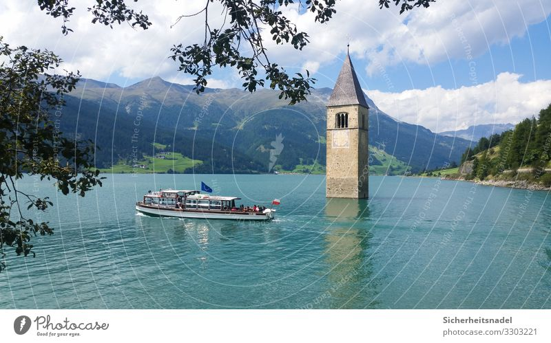 Reschensee Tourism Trip Nature Water Summer Beautiful weather Alps Mountain Lake Lake Reschen Church Boating trip Watercraft Blue South Tyrol Italy Reservoir