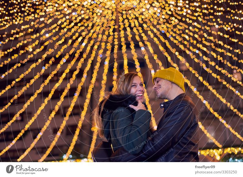 Young couple on the christmas lights of Vigo Happy Beautiful Vacation & Travel Winter Decoration Feasts & Celebrations Human being Couple Tree Town Building