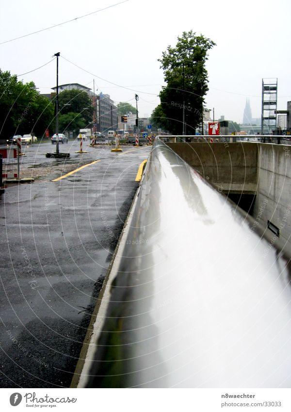 Far-off places Rain Glittering Wet Gloomy Construction site Steel Dome Traffic light Road traffic Vanishing point