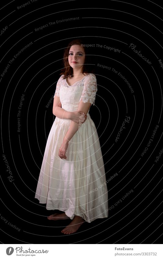 Bride stands barefoot in front of black background Human being Feminine Woman Adults Fashion Clothing Dress Stand Happy Thin Beautiful Black Emotions
