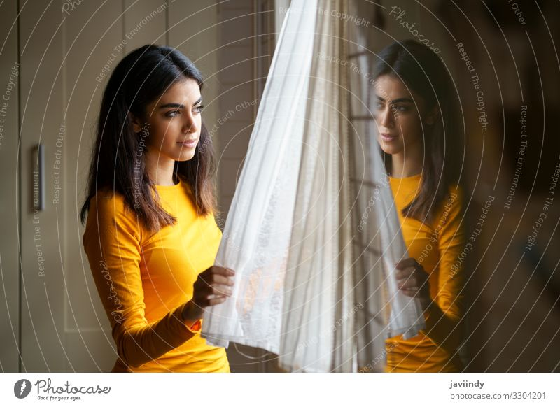 Persian woman while looking through the window Lifestyle Happy Beautiful Hair and hairstyles Face Relaxation Winter Flat (apartment) Human being Feminine