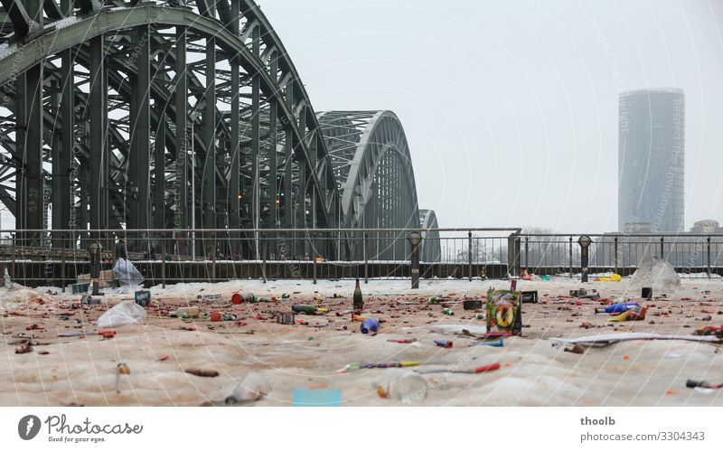 Remains of New Year's Eve in the snow at Cologne Rhine Bridge Lifestyle Joy Winter Snow Party Environment Climate Climate change Fog Town Downtown Deserted