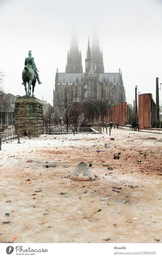 Remains of New Year's Eve in the snow at Cologne Cathedral Winter Snow Art Sculpture Architecture Culture Party Environment Climate Climate change Fog Town