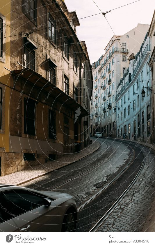 Town House (Residential Structure) Street Lanes & trails Car Transport Europe City trip Driving Downtown Railroad tracks Traffic infrastructure Mobility Vehicle
