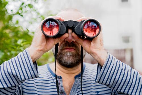 Man looks through binoculars into the distance Human being Masculine Adults Observe Discover Expectation Inspiration Problem solving Curiosity Perspective
