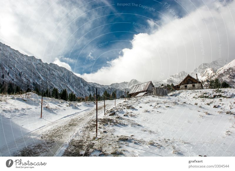 Mountain Hut with Snow between High Mountains in Winter in Austria abandoned alp alpine alps austria calm climate climate change clouds cloudscape cold