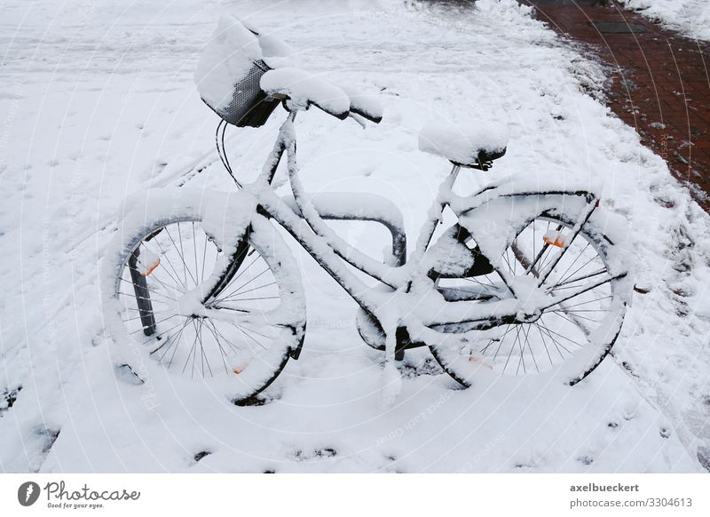 snowed-in bicycle Lifestyle Winter Climate Weather Ice Frost Snow Snowfall Town Transport Means of transport Traffic infrastructure Road traffic Cycling Street