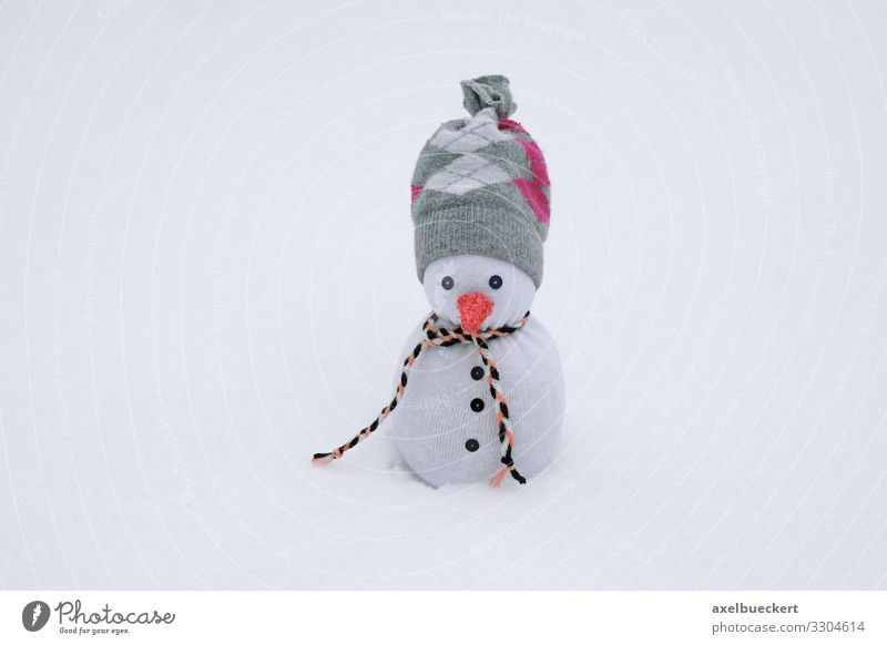 Socks snowman in the snow Leisure and hobbies Winter Climate Weather Snow Stockings Scarf Cap Exceptional Funny Snowman Creativity Handcrafts Decoration