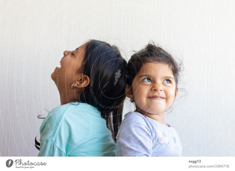 Two little girls looking at each other Lifestyle Joy Happy Face Child School Schoolchild To talk Human being Feminine Baby Toddler Girl Sister