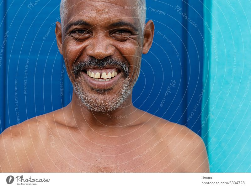 cuban man in a blue street , cuba Lifestyle Happy Island Human being Masculine Man Adults Skin Head Face Eyes Ear Nose Mouth Lips Teeth Facial hair Breasts Arm