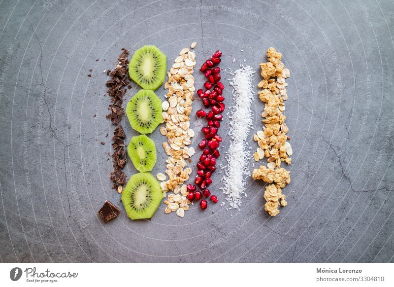 Vegan and organic ingredients for a healthy snack. Fruit Dessert Breakfast Vegetarian diet Diet Authentic Fresh Raw chocolate Coconut kiwi Vegan diet Oats grain