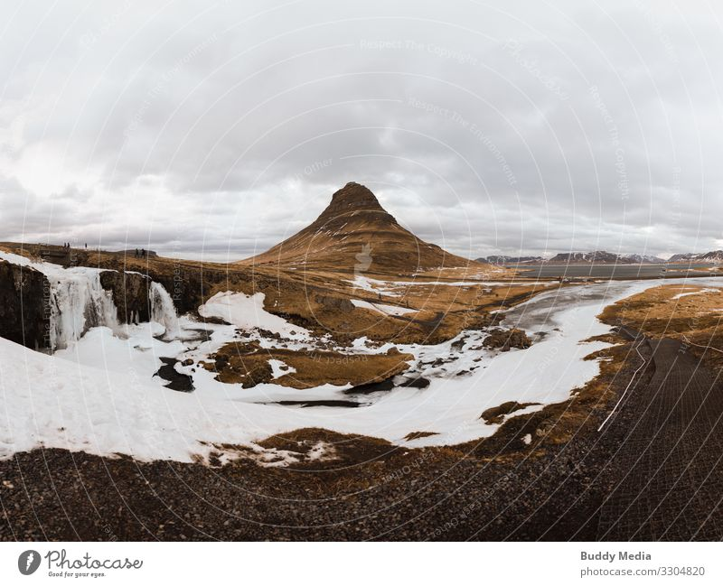 Kirkjufellsfoss on the Snaefellsnes Peninsula in Iceland Expedition Winter Mountain Nature Landscape Earth Sand Water Sky Clouds Spring Weather Snow Drought