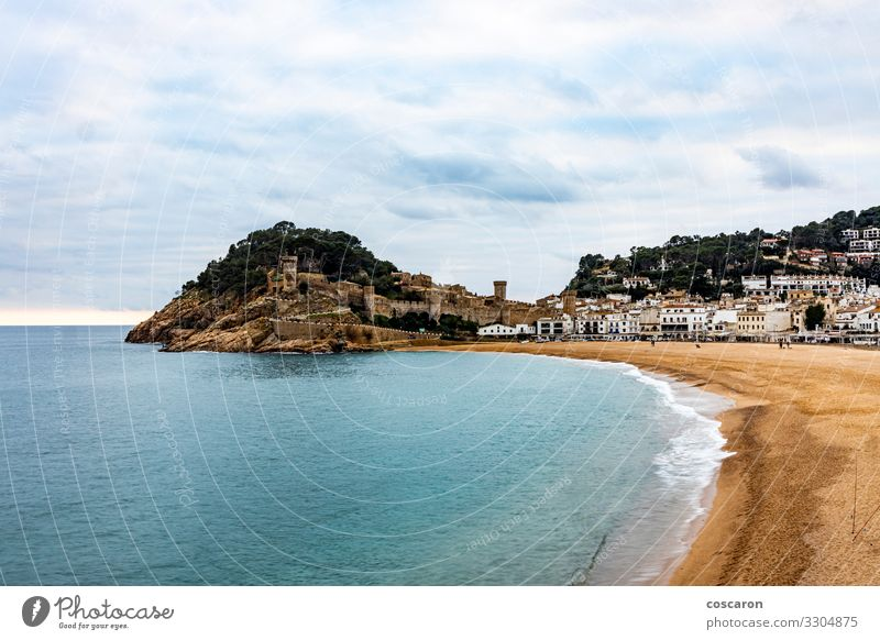 Air view of the beach and the wall of Tossa de Mar Vacation & Travel Tourism Sightseeing Beach Ocean Nature Landscape Sand Sky Clouds Storm clouds Waves Coast