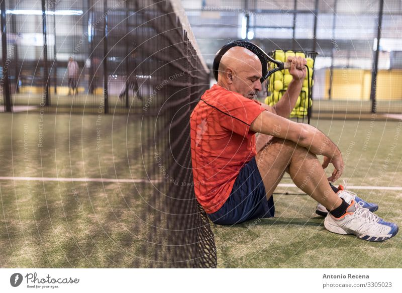 senior man playing paddle tennis at indoors pitch, he is tired Playing Sports Man Adults Bald or shaved head Beard Old Competition padel Court building match