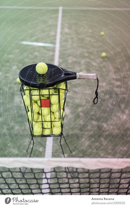 Paddle tennis rackets, balls and basket in court Life Sports Ball Effort paddle tennis padel Still Life Object photography Racket Court building Playing field