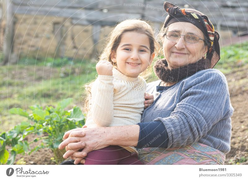 Portrait of a happy little girl with her senior grandmother at garden Lifestyle Style Playing Garden Mother's Day Child Human being Girl Woman Adults