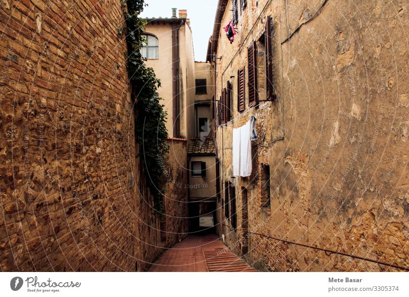 A narrow, brick walled medieval street in St. Gimignano, Italy. Vacation & Travel San Gimignano Old town Tunnel Architecture Wall (barrier) Wall (building)