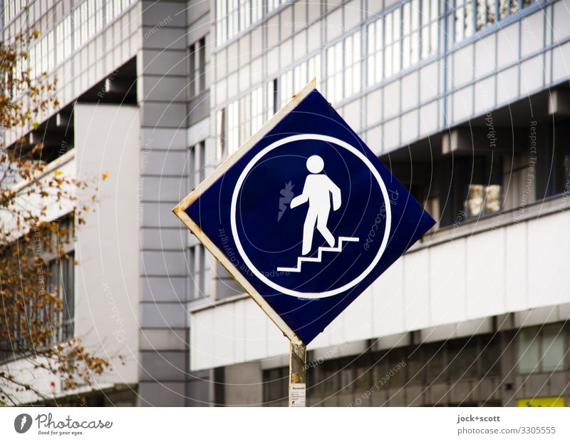 To the underpass GDR Leipziger Straße Underpass Stairs Facade Pedestrian Lanes & trails Signage Warning sign Pictogram Going Authentic Sharp-edged Modern Retro