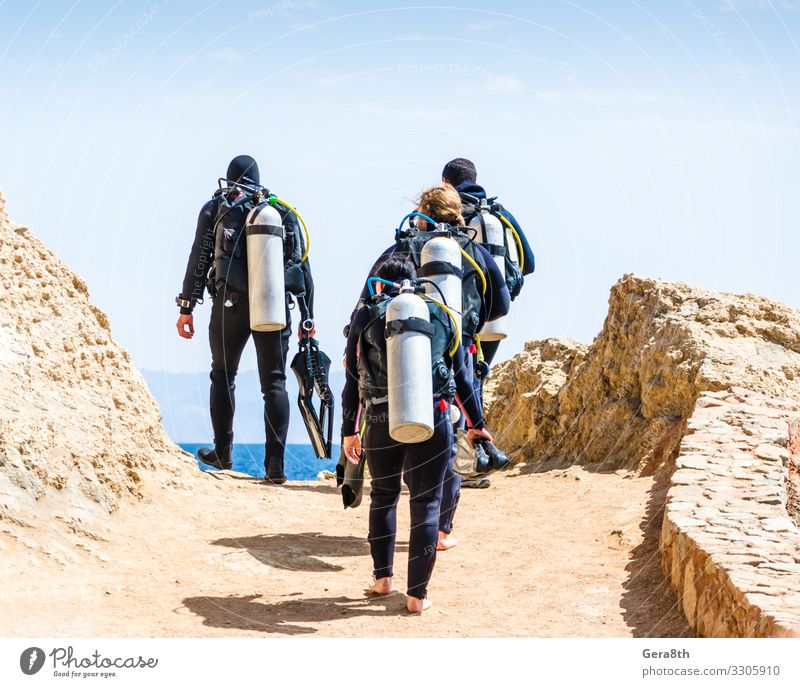 divers go to the sea on the sky with clouds in Egypt Dahab Exotic Relaxation Leisure and hobbies Vacation & Travel Tourism Summer Ocean Sports Dive Group Nature