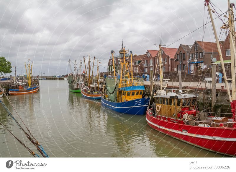 Neuharlingersiel in East Frisia Ocean Culture Water Fishing village Harbour Fishing boat Watercraft Tradition Drop anchor Jetty Crab cutter East Frisland