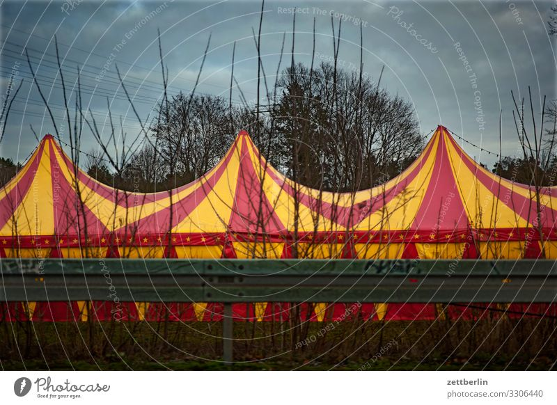 circus tent Domed roof Entertainment Shows Traveling circus Circus Circus tent Circus trailer Tent Tarpaulin Colour Multicoloured Striped Street Crash barrier