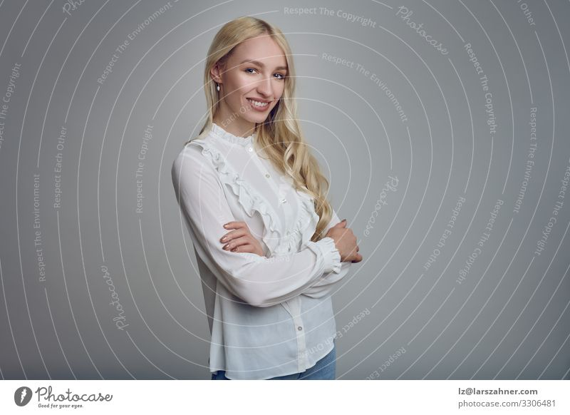 Young smiling blond woman with her arms folded Face Decoration Woman Adults 1 Human being 18 - 30 years Youth (Young adults) Blonde Long-haired Smiling
