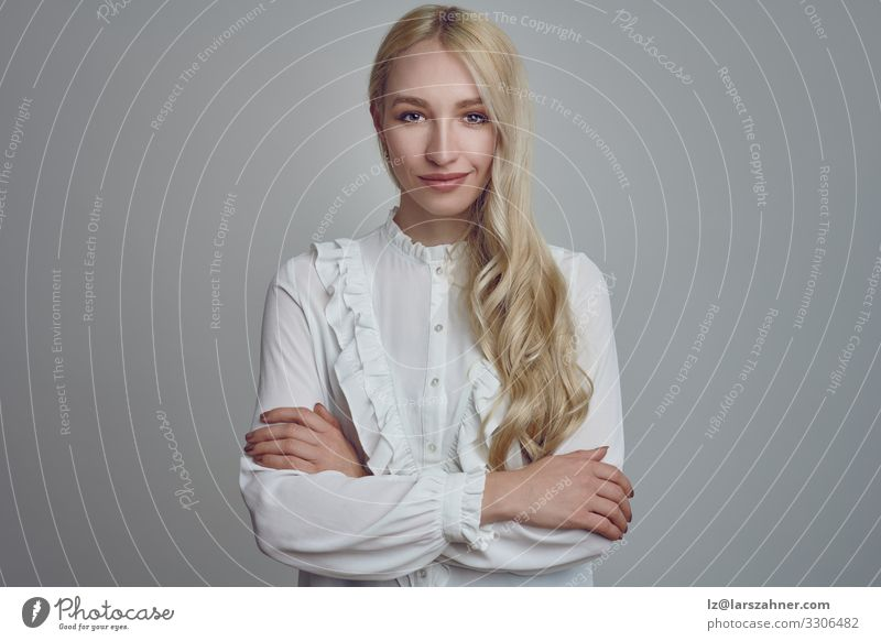 Young long-haired blond woman with her arms folded Woman Human being Youth (Young adults) 18 - 30 years Face Adults Copy Space Decoration Blonde Smiling