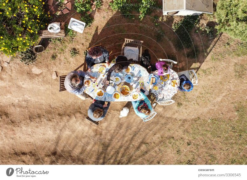 Large family eating together outdoors. Air view Food Baked goods Eating Lunch Dinner Banquet Picnic Beverage Cold drink Lifestyle Happy
