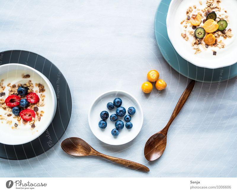 Healthy breakfast with yoghurt, muesli and fruits Food Yoghurt Fruit Grain Cereal Oat flakes Raspberry Blueberry Nutrition Breakfast Diet Plate Bowl Spoon