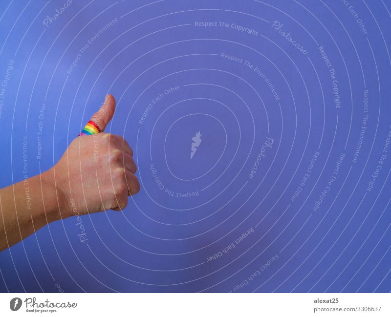 Thumb up with rainbow band on purple - Positive gay concept Freedom Success Business Homosexual Arm Hand Fingers Flag Good Joie de vivre (Vitality) Acceptance