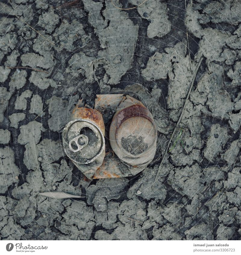 old rusty can on the dry puddle, global warming broken metallic object isolated alone abandoned still life garbage Climate change ground land sand