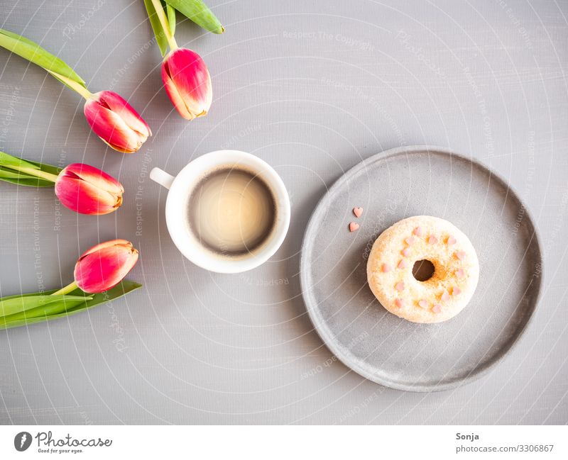 Pink tulips with a cup of coffee and a donat Food Dough Baked goods Nutrition Breakfast To have a coffee Beverage Hot drink Coffee Plate Cup Lifestyle Flower