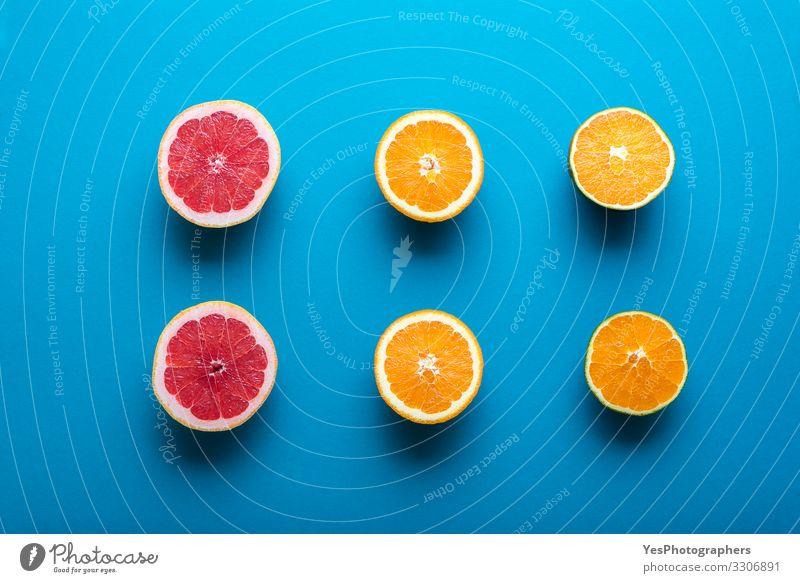 Fresh oranges and grapefruit cut in half. Halves of citrus fruit Food Fruit Orange Breakfast Organic produce Vegetarian diet Diet Healthy Eating Natural Blue