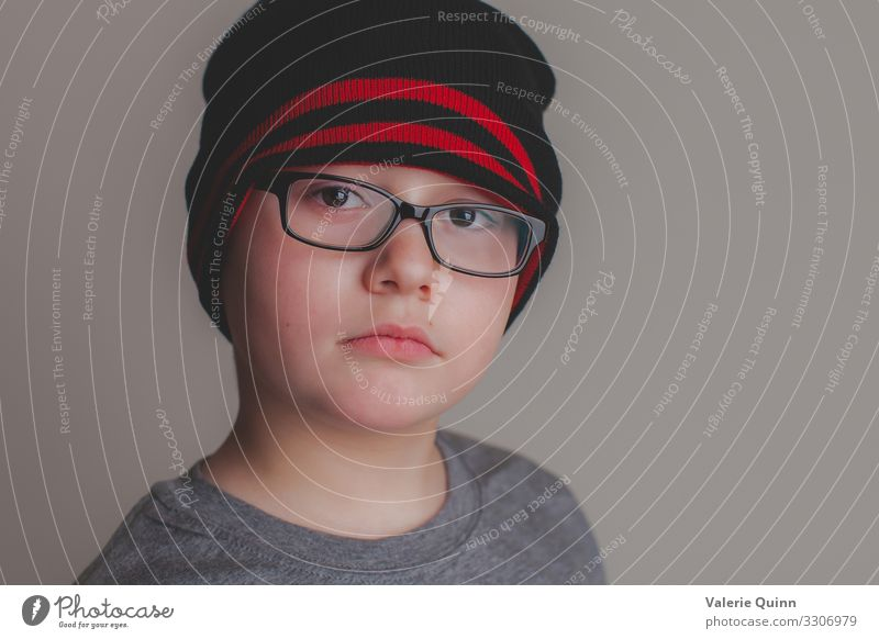 Young Boy Child Boy (child) 1 Human being 3 - 8 years Infancy Eyeglasses Hat Authentic Near Uniqueness childhood Calm Still Life Interior shot natural light