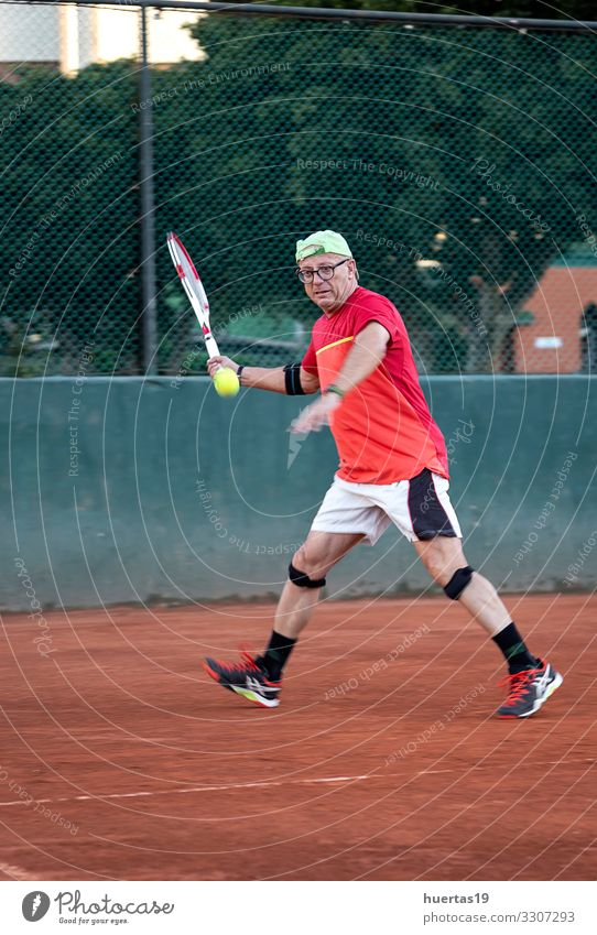 A middle-aged man plays tennis Lifestyle Playing Sports Human being Masculine Man Adults 1 45 - 60 years Old Competition Racket ball Tennis fitness court Player