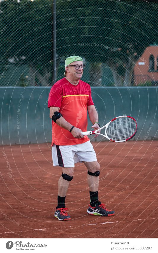A middle-aged man plays tennis Lifestyle Playing Sports Ball sports Human being Masculine Man Adults 1 45 - 60 years Old Competition Racket ball Tennis